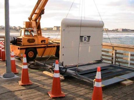 A prototype of Resolute Marine Energy's SurgeWEC device, under development in a Newburyport research lab, awaited deployment for a test in the waves off Nags Head, N.C., in December.